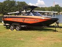 Check out this 2008 Malibu with low hours. Perfect boat