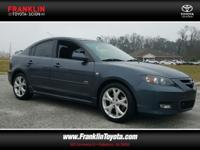 Mazda3 s Touring, 2.3L 4-Cylinder SMPI DOHC, and Gray.