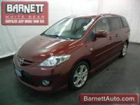 This vehicle is loaded with ALLOY WHEELS, REAR SPOILER,