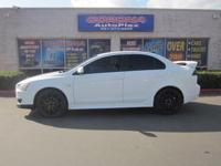 This is a lovely WHITE 2008 MITSUBISHI LANCER GTS 4