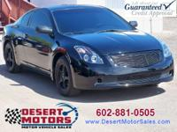 Check out this beautiful black on black Nissan Altima S