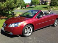 Beautiful condition, dark red hard top convertible. Two