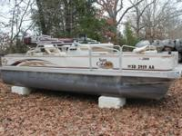This is a 2008 pontoon boat, 20' long x 8' wide, with