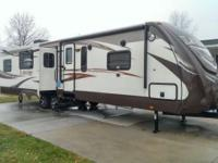 Recreational Vehicle Kind: Travel Trailer. Year: 2014.