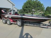 Equipped with an 250 HP Evinrude E-tec motor. The boat