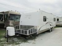 Weight: 5,695 Length: 30' A 30' TT/Toy Hauler with one