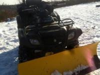 This 4 wheeler has low miles,great tires ,winch, snow