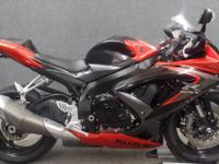 This is a 2008 Suzuki GSXR750 in Orange and black