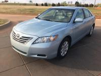We are excited to offer this 2008 Toyota Camry Hybrid.