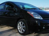 javascriptwriteDescriptionOur 2008 Toyota Prius just