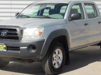 This low mileage Toyota Tacoma has barely been touched.