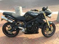This is a beautiful 2008 Street Triple with just over