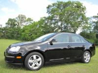 Options Included: Black Solid Paint, (4) Jetta Carpeted