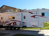 2008 FTL 4005 TRIPLE SLIDE OUTS WITH 12 FOOT GARAGE....