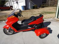 I have a Red 2008 Yamaha Majesty Trike 400cc scooter to