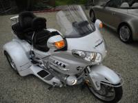 Bike is in like new condition in pearl white color with
