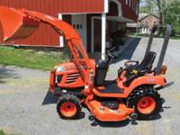 This is a 2008 Kubota BX2350 4x4 Compact tractor w/