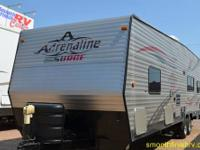 This 2009 Adrenaline Surge Toy Hauler/ Travel Trailer