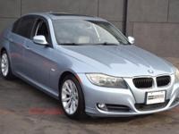 This 2009 BMW 3 Series 4dr 328i features a 3.0L