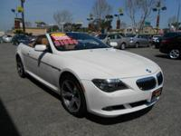 This ALPINE WHITE 650I HAS A GORGEOUS CAMEL COLOR