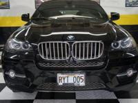 This 2009 BMW X6 4dr AWD 4dr 50i SUV showcases a 4.4 L