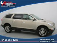 This is a 2009 Buick Enclave CXL that is Gold Mist