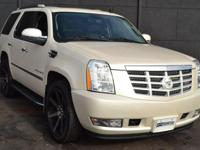 This 2009 Cadillac Escalade 4dr AWD 4dr features a 6.2L