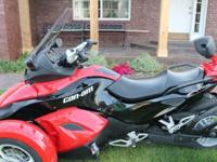 This is a semi-automatic 2009 Can-Am Spyder RS SE5. SE5