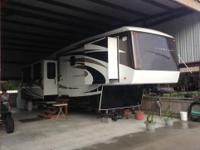 This amazing 2009 Carriage Carri-Lite 36SBQ RV has been