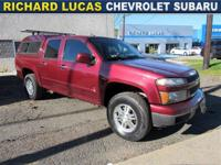 From mountains to mud, this Red 2009 Chevrolet Colorado