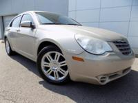 Limited trim. Heated Leather Seats, Multi-CD Changer,