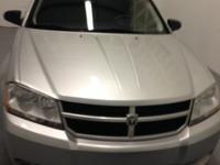 A lovely 2009 silver Dodge Avenger V6 SE 2.7 L DOHC