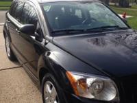 84,719 miles 4 cylinder 4 door Black and blue interior