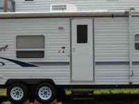 - 27ft Tow-behind travel trailer w/aluminum siding - NO
