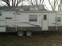 Paid 22,000 new. Asking 11,000 obo. 1/2 ton towable.