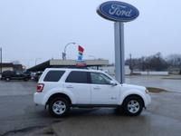 Here is a Ford Escape hybrid in excellent condition.