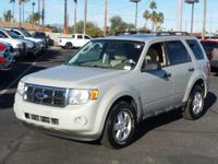 This 2009 Ford Escape XLT, has a great Tan exterior,