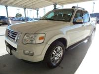 From mountains to mud, this White 2009 Ford Explorer