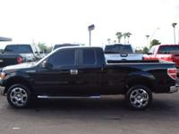 This 2009 Ford F-150 4WD SuperCab 145 XLT features a
