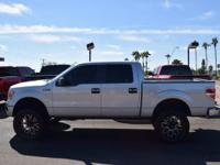 This 2009 Ford F-150 4WD SuperCrew 145 XLT features a