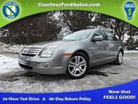 This Fusion is equipped with Navigation, Sunroof, SYNC,