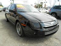 This TUXEDO BLACK CLEARCOAT FORD FUSION IN GREAT SHAPE