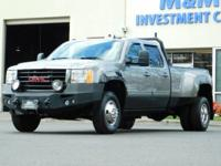 This is a 2009 GMC Sierra 3500HD SLT Crew Cab 4-Door