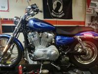 This is 2009 Harley 883 custom with 700 miles, custom