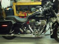 2009 HD FLHX black, 10,000mi. showroom condition.
