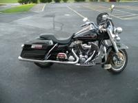 This 2009  vivid black Harley Davidson FLHR Road
