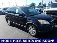 This outstanding-looking 2009 Honda CR-V is the