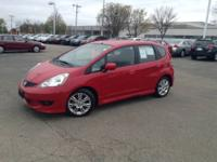 Load your family into the 2009 Honda Fit! Demonstrating