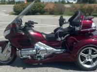 This 2009 Roadsmith Goldwing GL18HPM trike is loaded,
