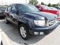 Check out this 2009 Honda Ridgeline RTL. Its Automatic